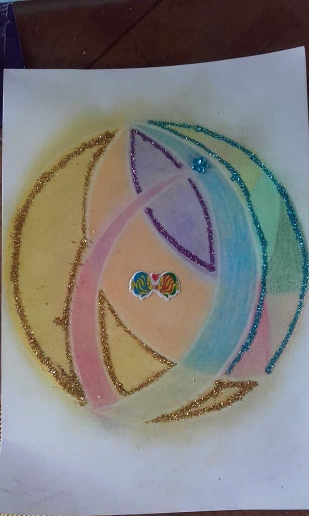 Mandala positif avec des crayons, paillettes et stickers